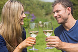 Cute couple toasting with white wine