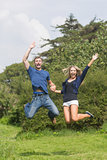 Cute couple jumping and smiling