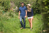 Cute couple walking holding hands