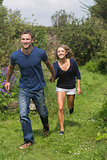 Cute couple running holding hands