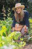 Cute blonde gardening on sunny day
