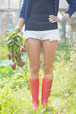 Woman holding home grown vegetables