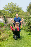 Man pushing his girlfriend in a wheelbarrow