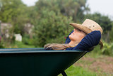 Pretty blonde napping in wheelbarrow