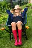 Pretty blonde napping in wheelbarrow