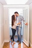 Cute couple walking through the door