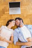 Cute couple lying on the floor