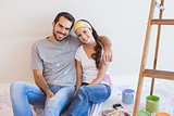 Cute couple about to paint living room