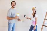 Cute couple painting the wall