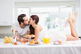 Young couple having a romantic breakfast