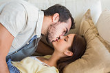 Cute couple kissing on couch