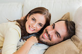 Cute couple relaxing on couch