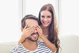 Pretty woman surprising her boyfriend
