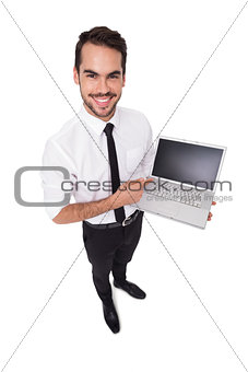 Smiling businessman pointing his laptop