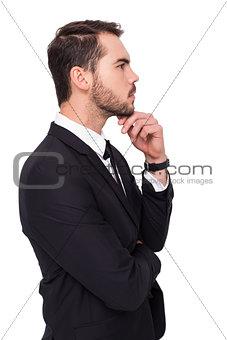 Thoughtful businessman touching his chin