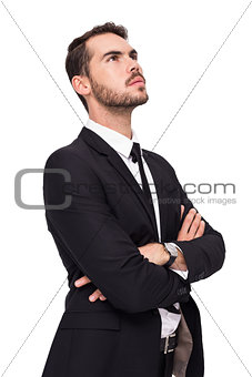 Thinking businessman with his arms crossed