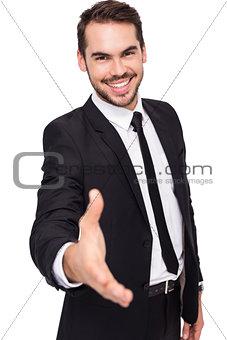 Portrait of smiling businessman offering handshake