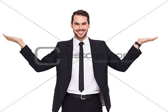 Businessman with open hands looking at the camera