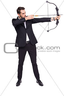 Businessman shooting a bow and arrow