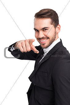 Happy businessman pointing his finger
