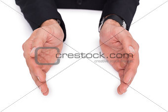 Close up of businessman with hands spread on the floor
