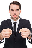 Frustrated businessman with closed fists looking at camera