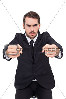 Angry businessman standing with clenched fists