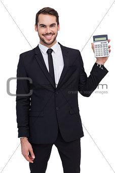 Smiling businessman presenting a calculator