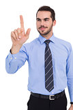 Happy businessman standing and pointing up