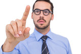 Businessman with glasses pointing something