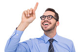 Happy businessman with glasses pointing