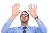 Businessman with arms raised and his fingers spread out