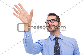 Smiling businessman standing with fingers spread out
