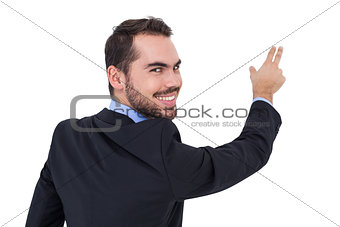 Smiling businessman pointing these fingers
