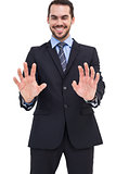 Happy businessman presenting his hands
