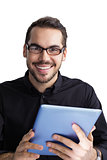 Smiling businessman in glasses holding tablet