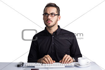Focused businessman with glasses using computer