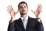Serious businessman with finger spread out
