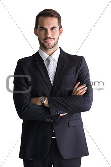 Smiling businessman posing with arms crossed