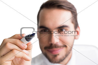 Portrait of happy businessman writing with marker