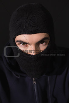 Portrait of burglar wearing a balaclava