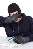 Hacker removing his balaclava to show his face
