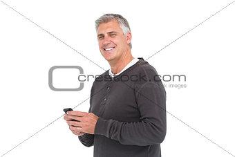 Casual man sending a text