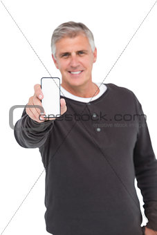 Casual man showing his smartphone
