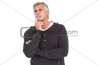Casual man thinking with hand on chin