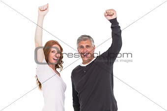 Casual couple cheering at camera