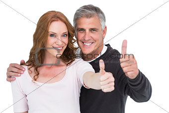 Casual couple showing thumbs up