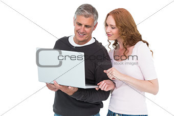 Casual couple using laptop together