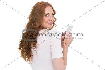 Pretty redhead sending text message