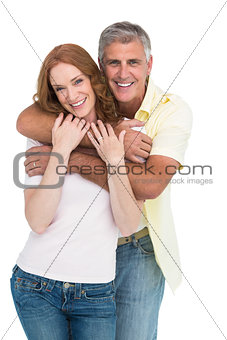 Casual couple smiling and hugging